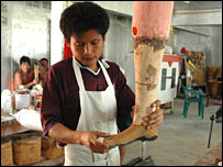 A worker in Dr Cynthia's prosthetics department