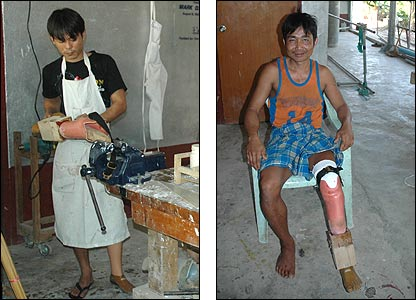 A worker with an artificial limb, and a grateful recipient trying on his new leg
