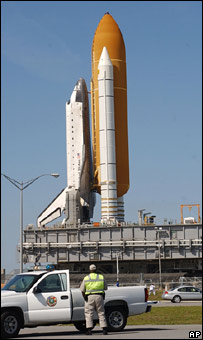 Shuttle rolls back to its hanger (AP)