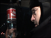 John Sweeney drinking a bottle of suspect vodka in Russia