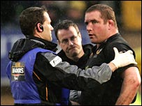 Phil Vickery receives treatment after the incident with Jason Hobson
