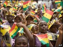 Schoolchildren wave Ghanaian flags in Accra