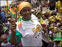 A woman in Accra waves a makeshift Ghanaian flag