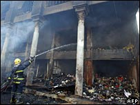 A fireman douses the smouldering ruins in Baghdad's booksellers' district