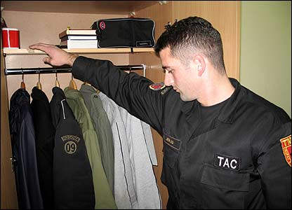 A supervisor inspects the room of cadet Blerand Hasanaj