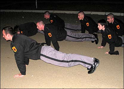 Cadets do press-ups after the lowering of the flag