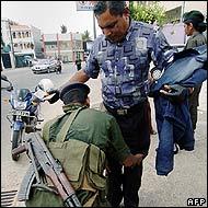 Police in Sri Lanka conduct a body search