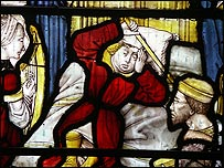 One of the windows, showing St Bernard with a headache
