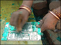 A woman stripping a printed circuit board (Image: EMPA)