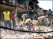 People hunt through rubble in Payakumbuh, west Sumatra
