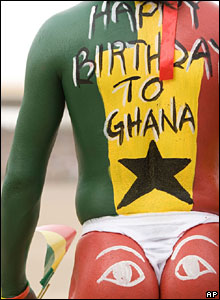 A man painted in the national colours of Ghana