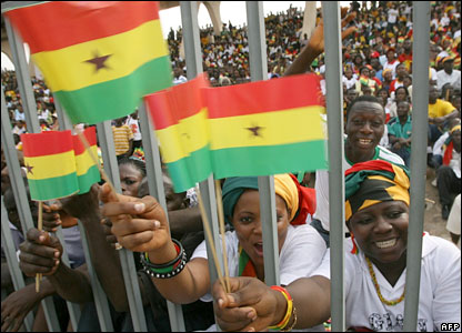 Ghanaians waving their national flag