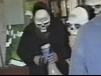 Animal rights activists in skull masks