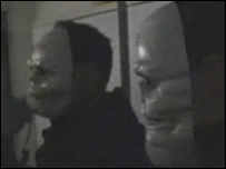 Activists in skull masks