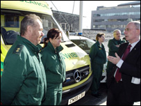 Health minister Dr Brian Gibbons meets ambulance staff