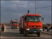 Trucks on a street in Hilla, 7 March 2007