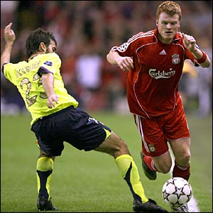 Barcelona's Oleguer and John Arne Riise of Liverpool