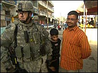 Lt Col Chad Mcree talks to Iraqis in Baghdad's Sadr City