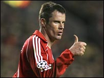 Jamie Carragher celebrates Liverpool reaching the last eight