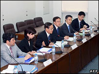 Japanese chief negotiator Koichi Haraguchi (c) with some of his staff at the talks