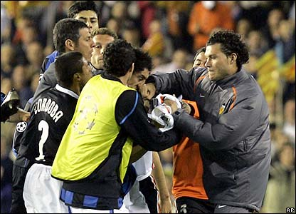 Valencia's subsitute David Navarro breaks Burdisso's nose
