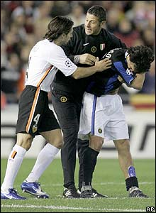 Valencia's Fabian Ayala and Inter's Francesco Toldo help Burdisso