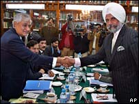 Indian Additional Secretary in External Affairs Ministry KC Singh, right, shakes hand with his Pakistani counterpart Tariq Osman Haider in Islamabad
