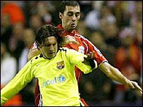 Barcelona's Lionel Messi is marked by Liverpool's Alvaro Arbeloa