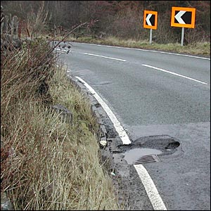 Potholes on the A809 in East Dunbartonshire, by Bill Thompson