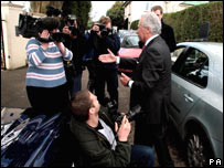 Lord Levy confronted by camera crews