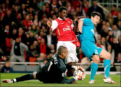 PSV Eindhoven's Heurelho Gomes saves at the feet of Arsenal's Emmanuel Adebayor