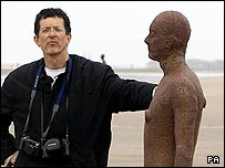 Antony Gormley with one of his iron men