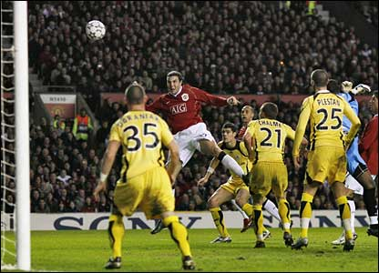 Manchester United's John O'Shea heads onto the bar