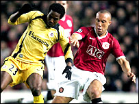 Lille's Kader Keita battles for the ball with Manchester United's Mikael Silvestre