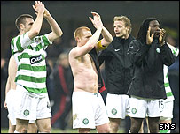 Celtic players salute the thousands of fans who followed them to Italy