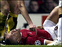 Man Utd defender Mikael Silvestre fell awkwardly after challenging for a header