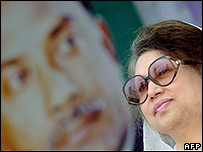 Khaleda Zia in front of poster of her father,  Zia Rahman