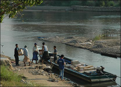 People loading up a boat to take over the river