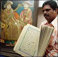 Police in Bangalore display the seized rare Koran