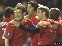 Osasuna celebrate Raul Garcia's early goal at Ibrox