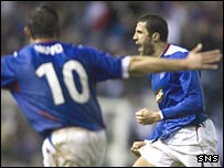 Brahim Hemdani (right) celebrates his late goal at Ibrox