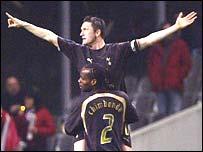 Robbie Keane celebrates scoring at Sporting Braga with Pascal Chimbonda