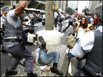 Riot police clash with protesters on the streets of Sao Paulo