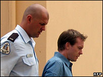 New Zealander Glenn McNeill (R), age 29, is led from the cells to the courtroom , Feb 2007
