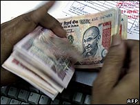 Man counting rupees