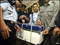 Indonesian officials carry the flight records for the doomed Garuda flight