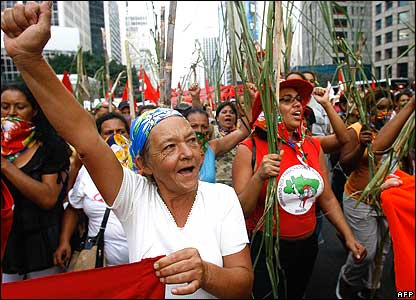 Farmers with the Landless Movement march with sugar cane