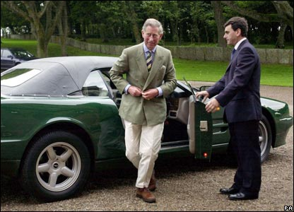 Prince Charles getting out of an Aston Martin