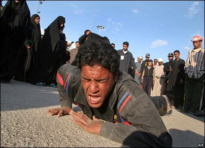 A Shia devotee crawls on his stomach in Karbala on 6 March