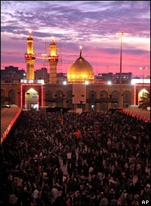 Pilgrims gather at dusk at the Imam Hussein mosque in Karbala on 7 March